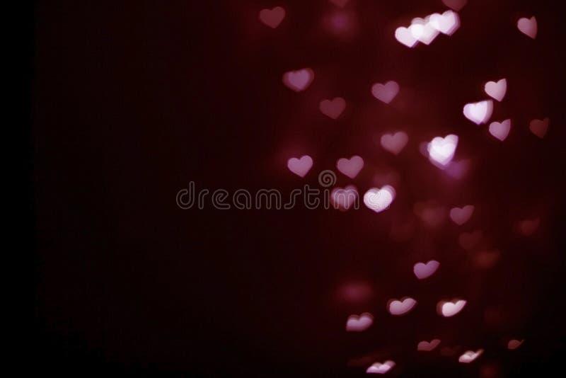 Запачканная глубоко - розовая предпосылка bokeh формы сердца стоковое фото rf