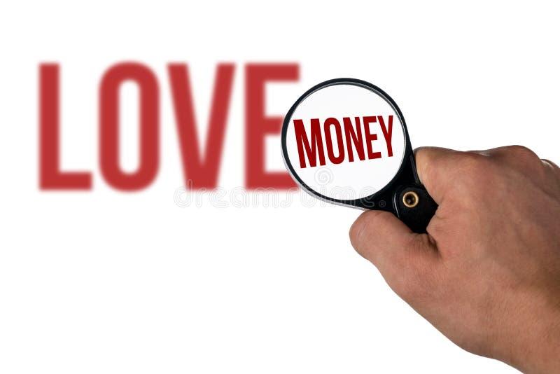 Запачканная литерность влюбленности, в деньгах лупы стоковые изображения