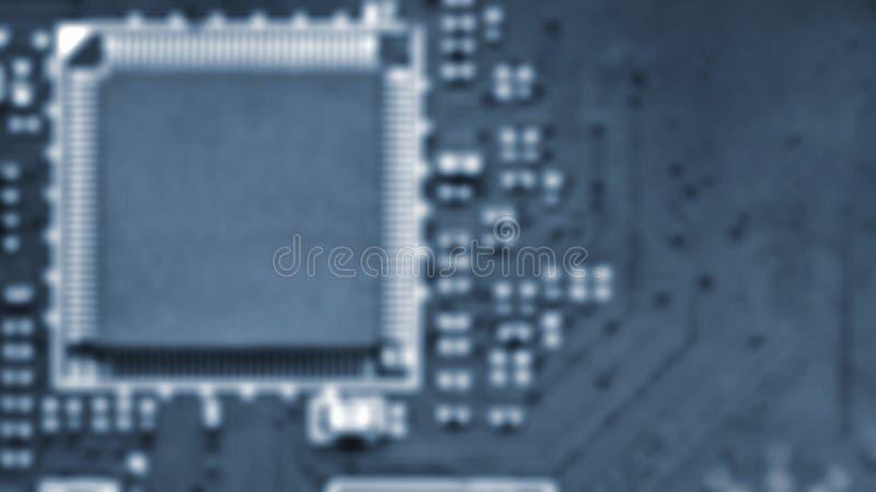 Запачканная предпосылка - плата с печатным монтажом с электрическими деталями Концепция для электротехники и современной технолог стоковые фото