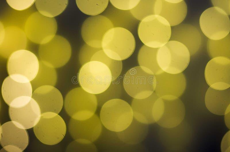 Запачканный свет bokeh в теплой предпосылке тона стоковое фото