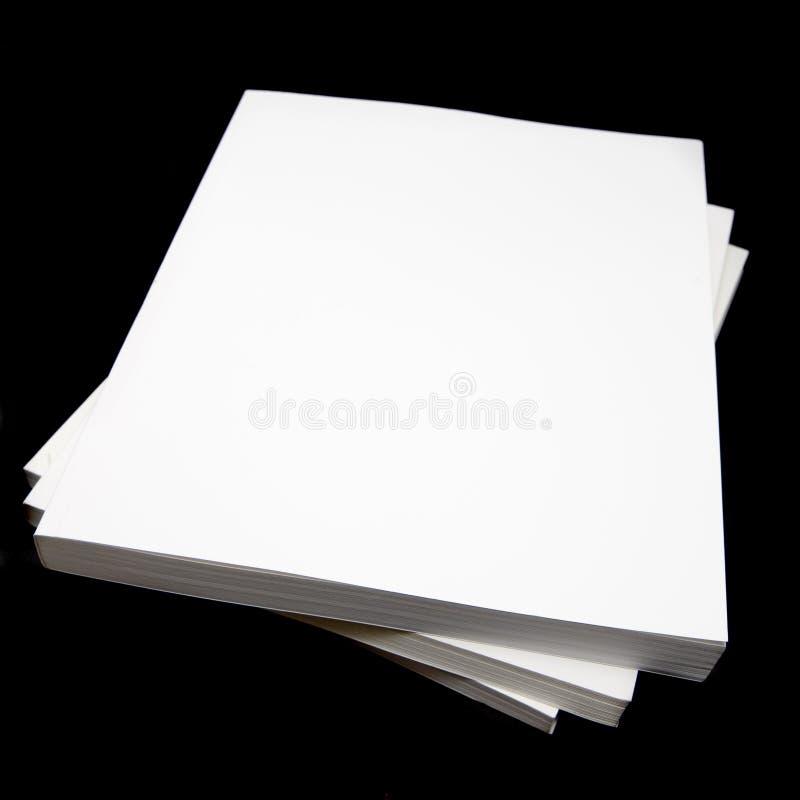 записывает книгу в мягкой обложке стоковое фото