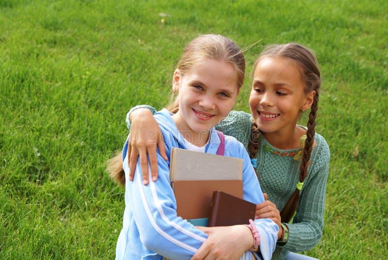 записывает школу девушок стоковые фото