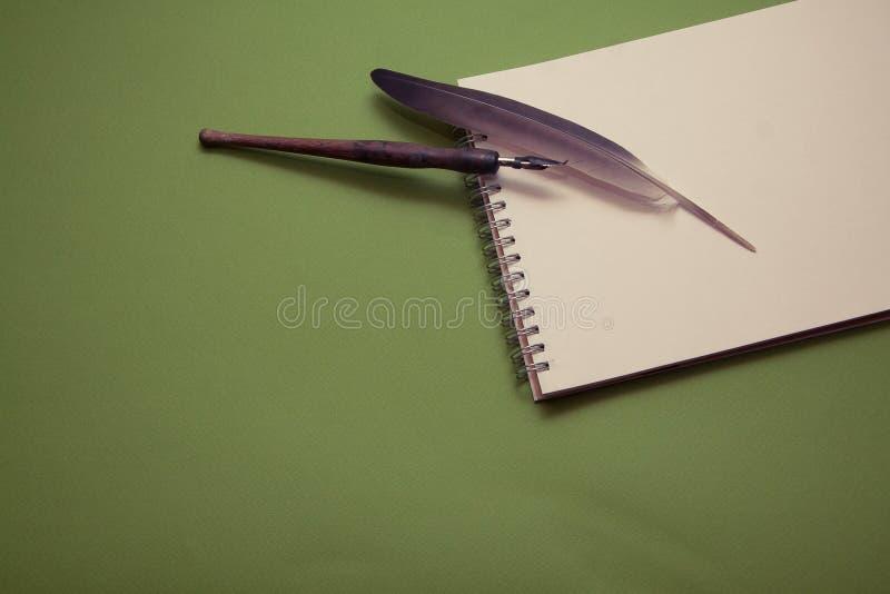 Запись в тетради стоковая фотография