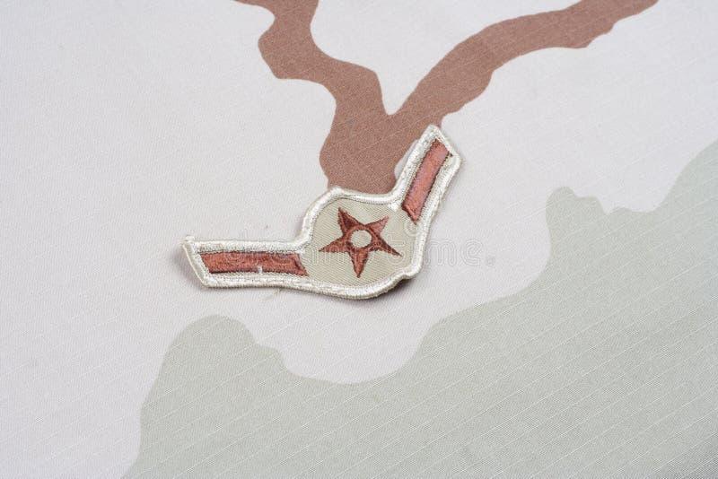Заплата летчика ВОЕННОВОЗДУШНОЙ СИЛЫ США шереножная на форме пустыни стоковые изображения