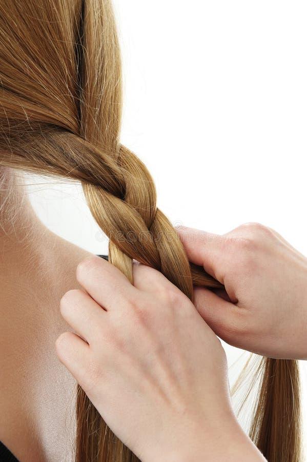 заплетает связанные волос стоковое фото
