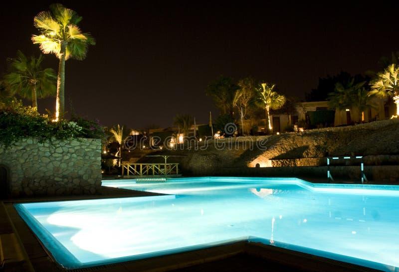 заплывание места бассеина ночи стоковое изображение