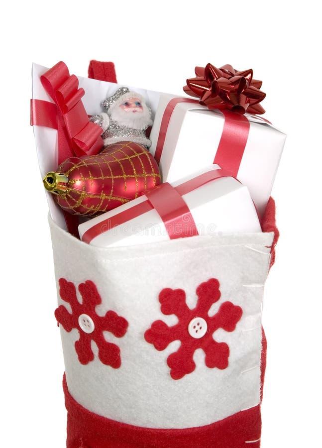 заполненное рождество представляет красный чулок стоковое фото