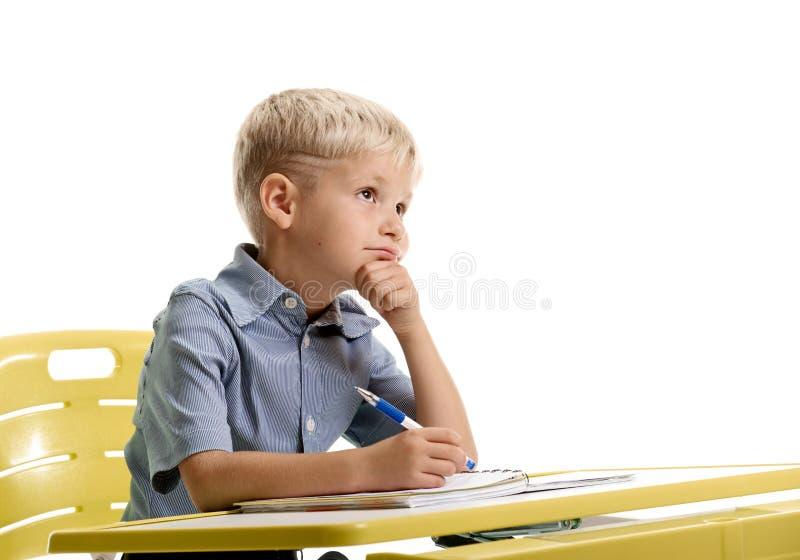 Запомненный мальчик на уроке стоковая фотография rf