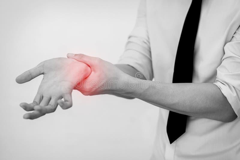Запястье руки человека офиса касающее тягостное стоковые изображения rf