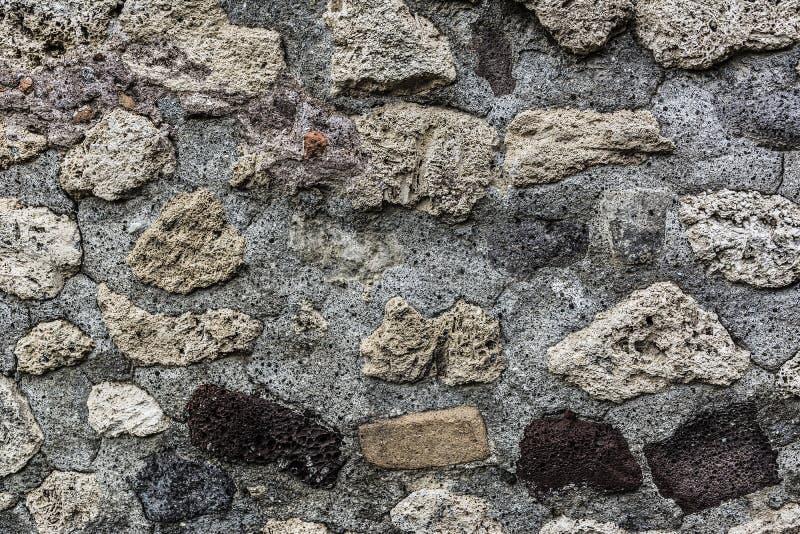 Запятнанная предпосылка стены камней стоковая фотография
