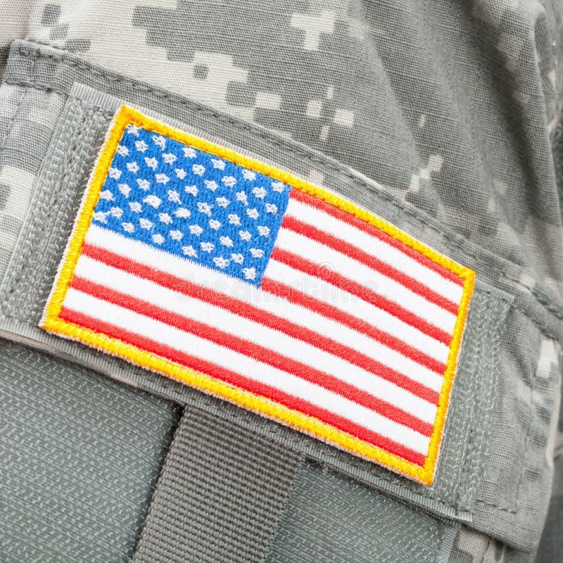 Заплата флага США на форме припоев - близкой поднимающей вверх съемке студии стоковые изображения