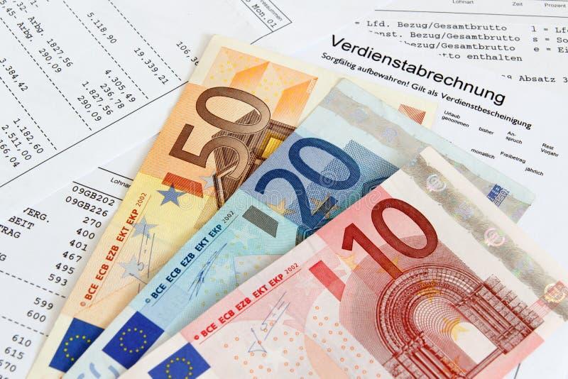 Зарплата с банкнотами стоковая фотография rf