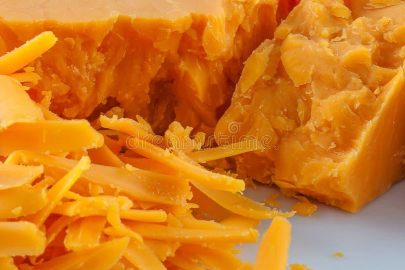 заскрежетанный сыр чеддера стоковое изображение rf
