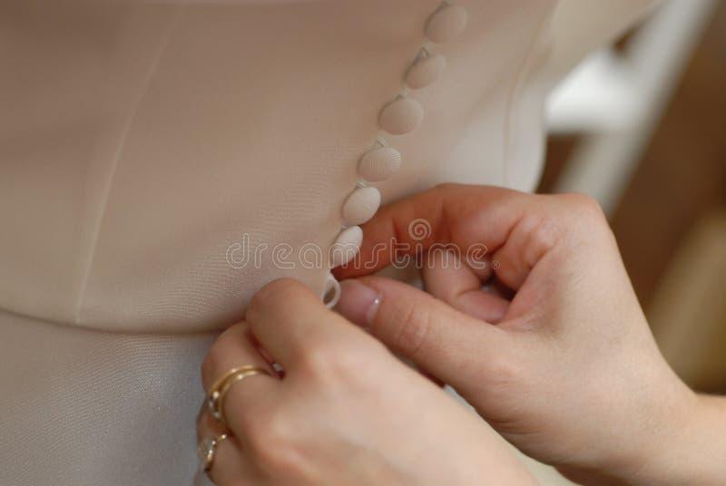 застегивать платье стоковые фото