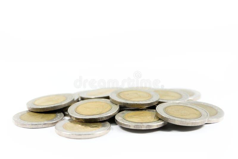 Затир золотых монеток серебра и куча стоковое изображение