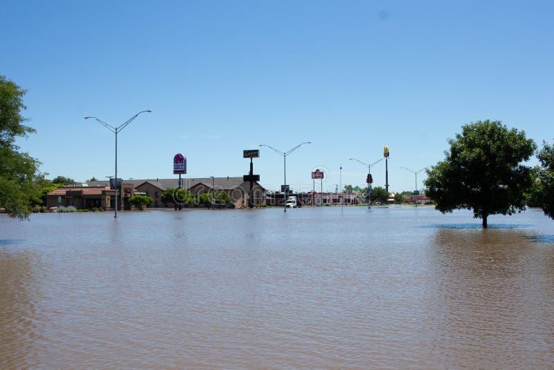 Затопляющ в Kearney, Небраска после проливного дождя стоковые фото