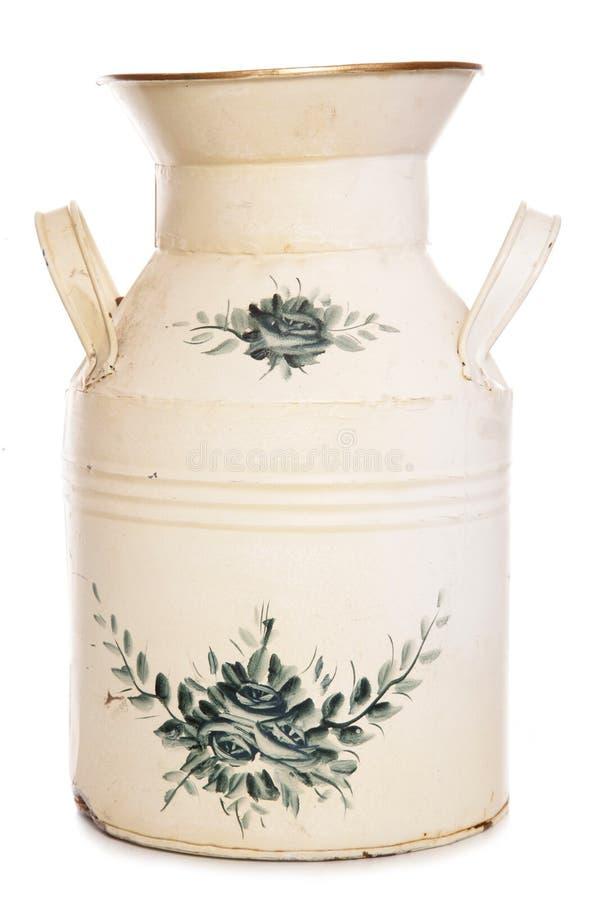 Затрапезная шикарная ваза маслобойки молока стоковое изображение rf