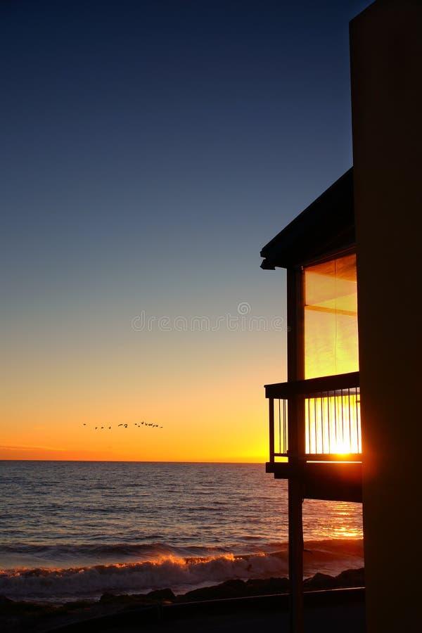 заход солнца балкона стоковое изображение