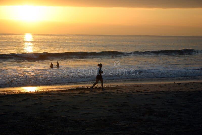 заход солнца бегунка стоковая фотография