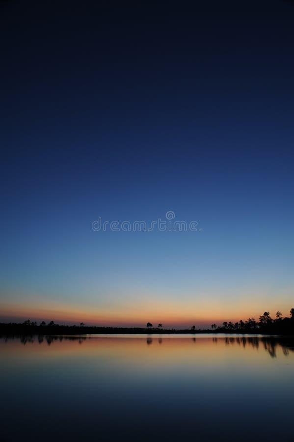 Заход солнца болотистых низменностей стоковые фото