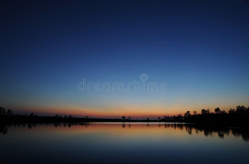 Заход солнца болотистых низменностей стоковые изображения