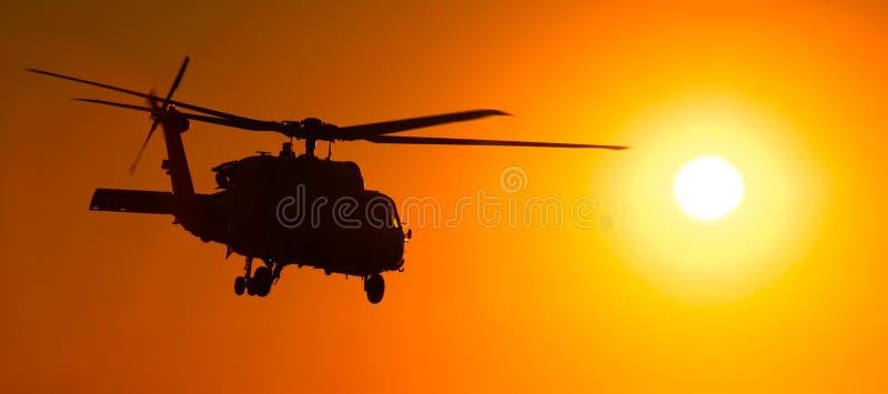 заход солнца вертолета 60 h стоковые изображения rf