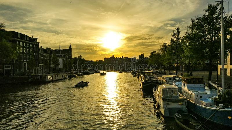 Заход солнца в Амстердам стоковые фото