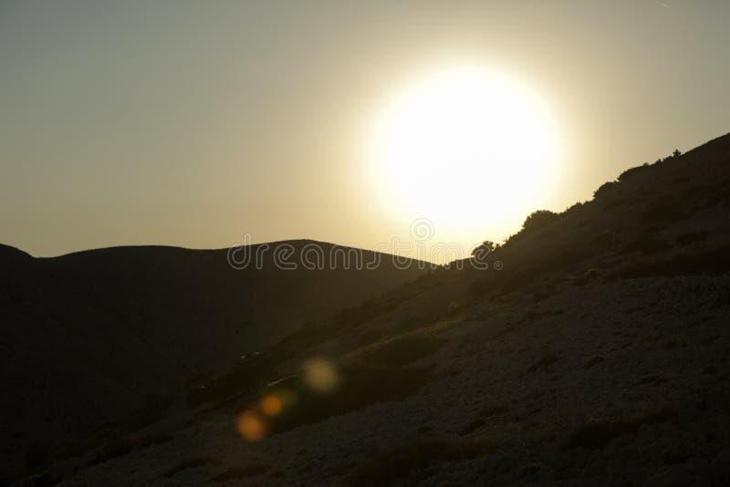 Заход солнца в горах Хорватии стоковые изображения