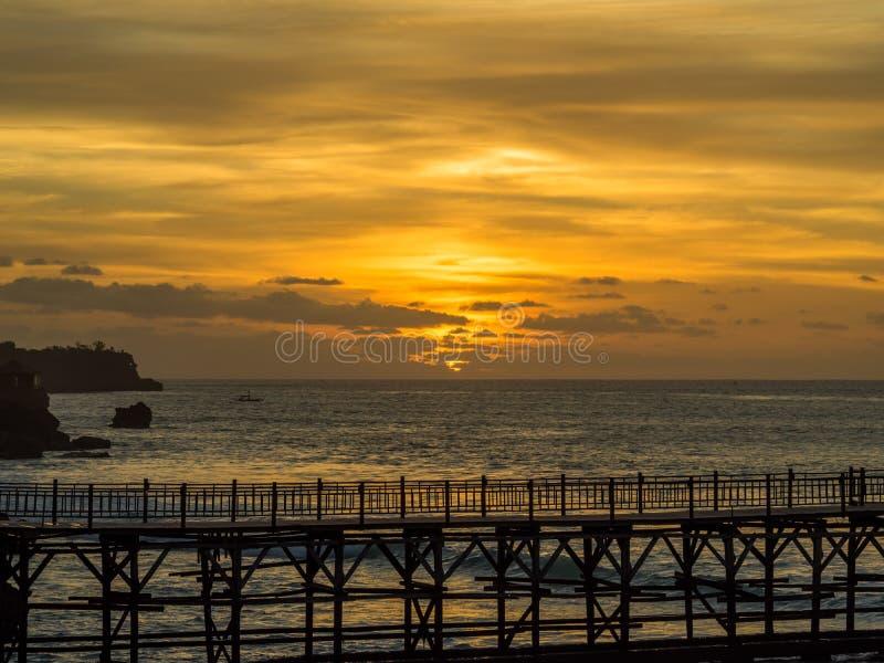 Заход солнца в заливе Бали Jimbaran стоковые изображения rf