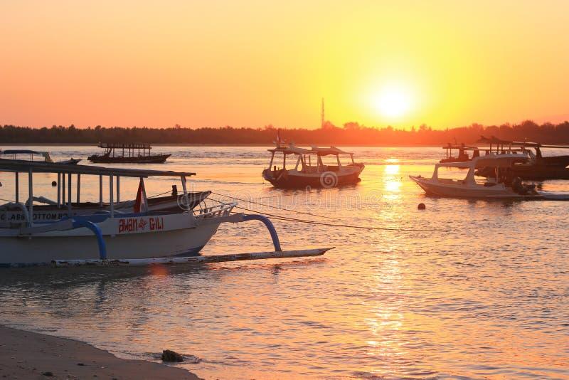 Заход солнца в острове Gili так много холодном стоковое фото
