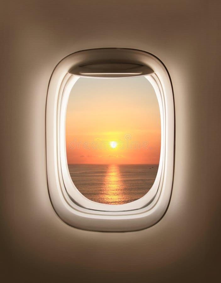 Заход солнца в porthole стоковая фотография rf