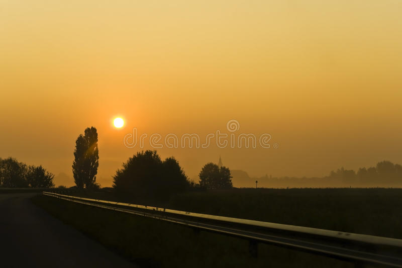 заход солнца дороги стоковая фотография rf