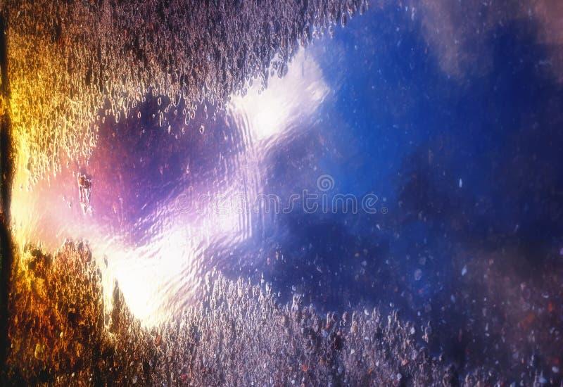 заход солнца лужицы цветов стоковое изображение rf