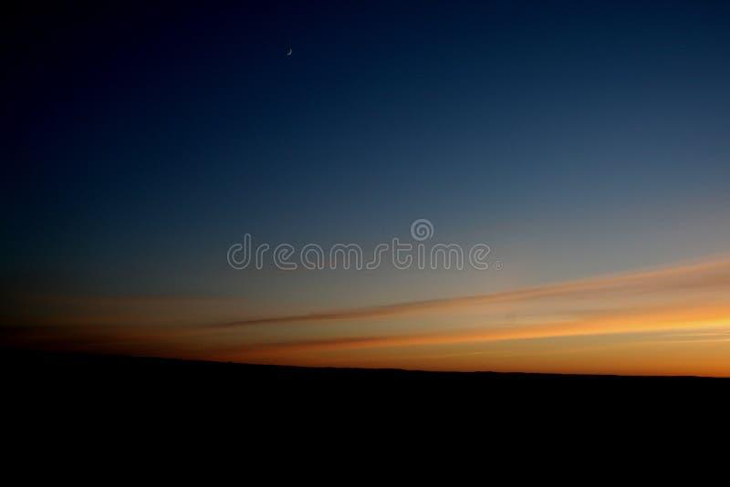 заход солнца луны стоковое фото rf