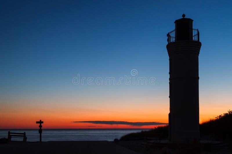 заход солнца маяка стоковая фотография rf