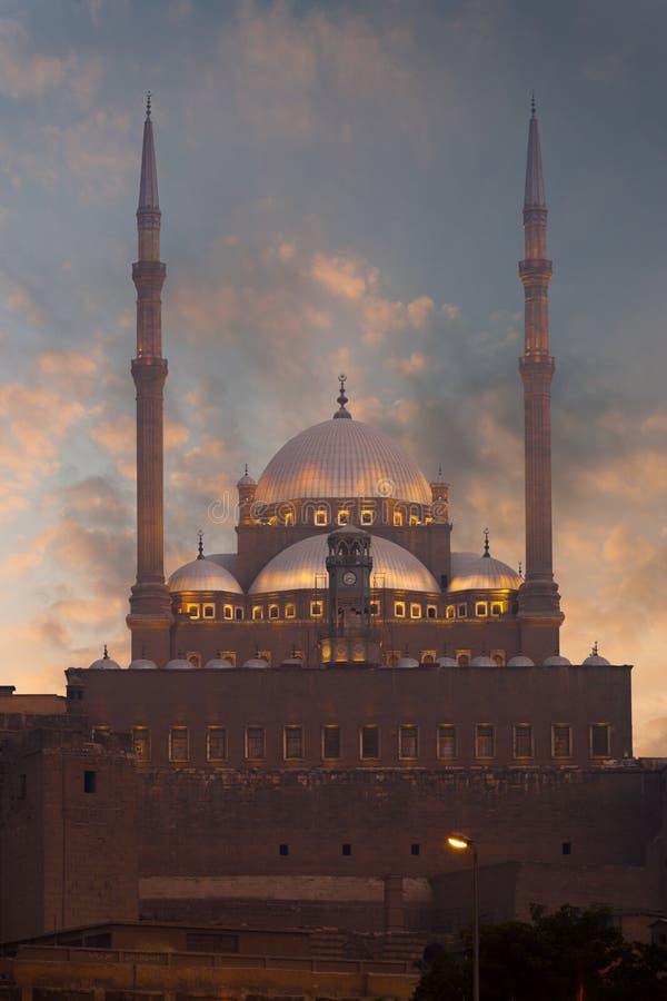 заход солнца минаретов цитадели Каира стоковые изображения