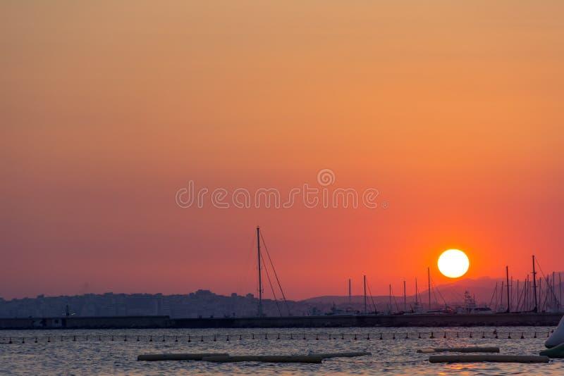 Заход солнца над Афинами, заход солнца над морем, Грецией стоковое фото rf