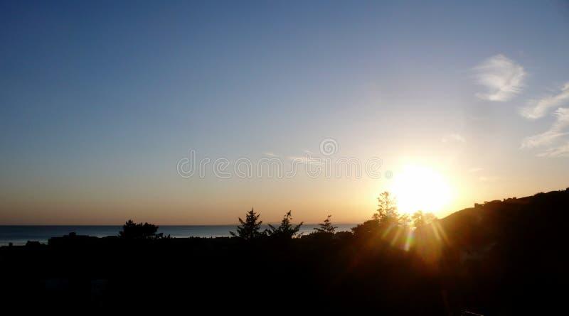 Заход солнца над версией b холма стоковая фотография