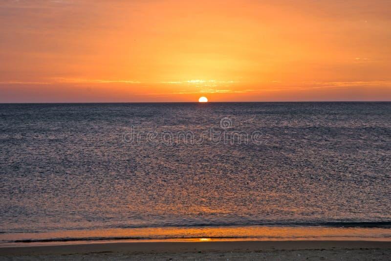 Заход солнца на карибском пляже стоковое фото
