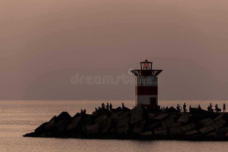 Заход солнца на маяке стоковые фотографии rf