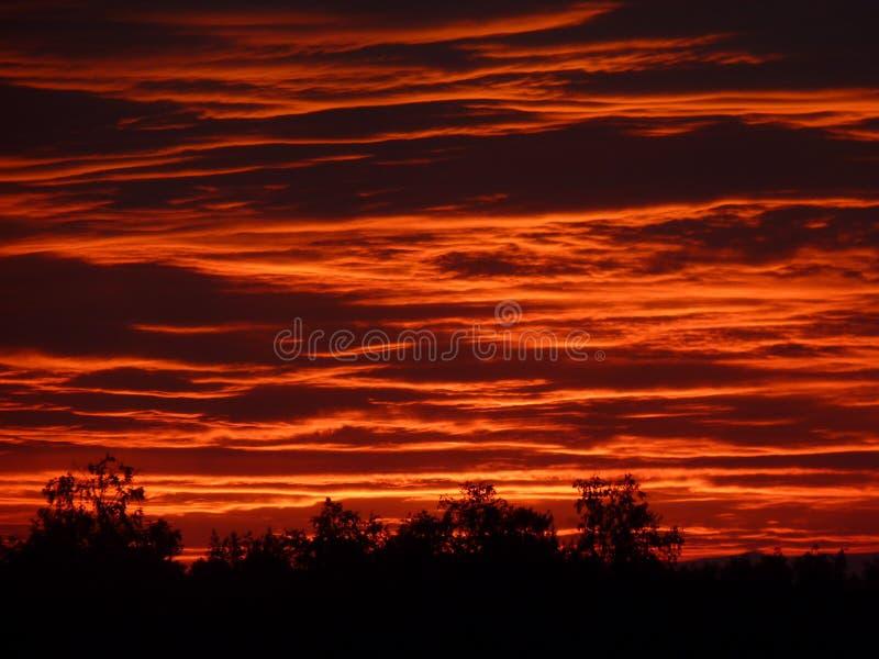 Заход солнца на море озера стоковое фото