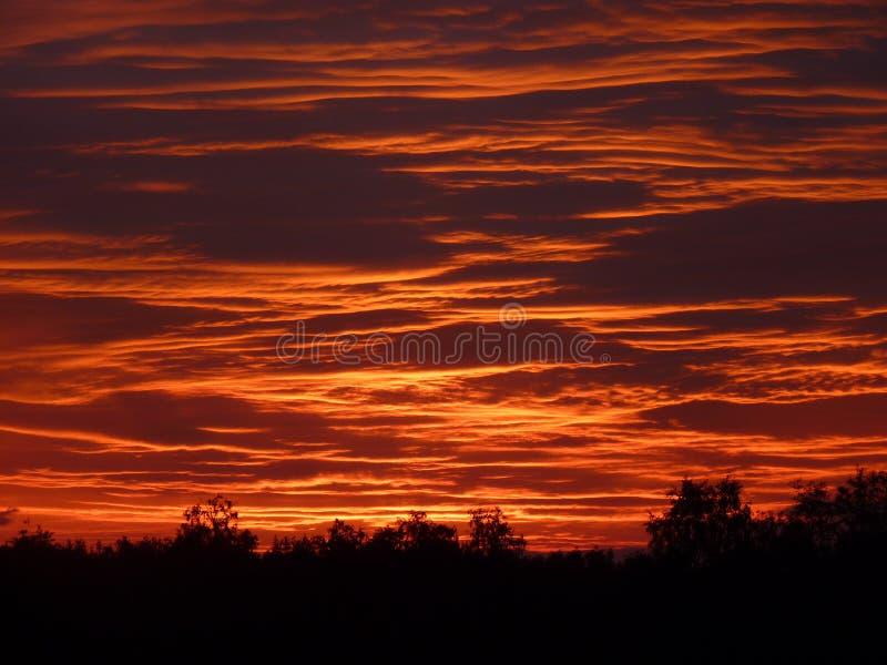 Заход солнца на море озера стоковая фотография