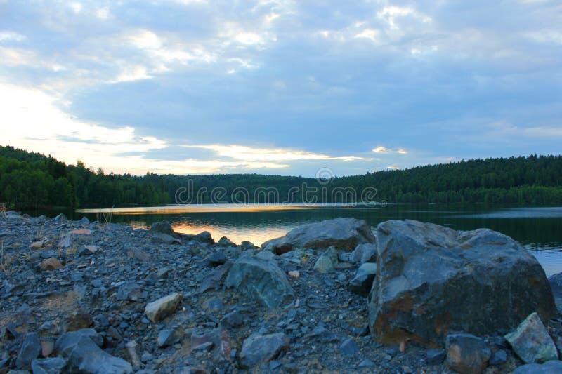 Заход солнца на озере percee pierre стоковые фотографии rf