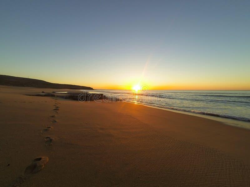 Заход солнца на пляже, Ericeira стоковые фото