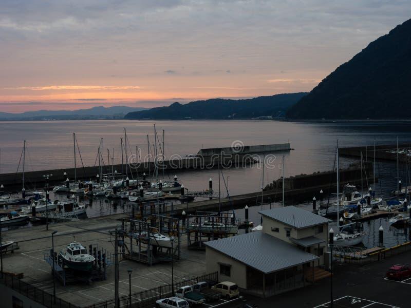 Заход солнца на порте Beppu - префектуре Oita, Японии стоковые фото