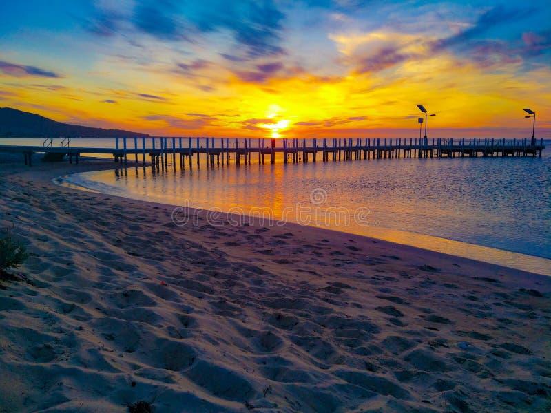 Заход солнца на пристани стоковые фото