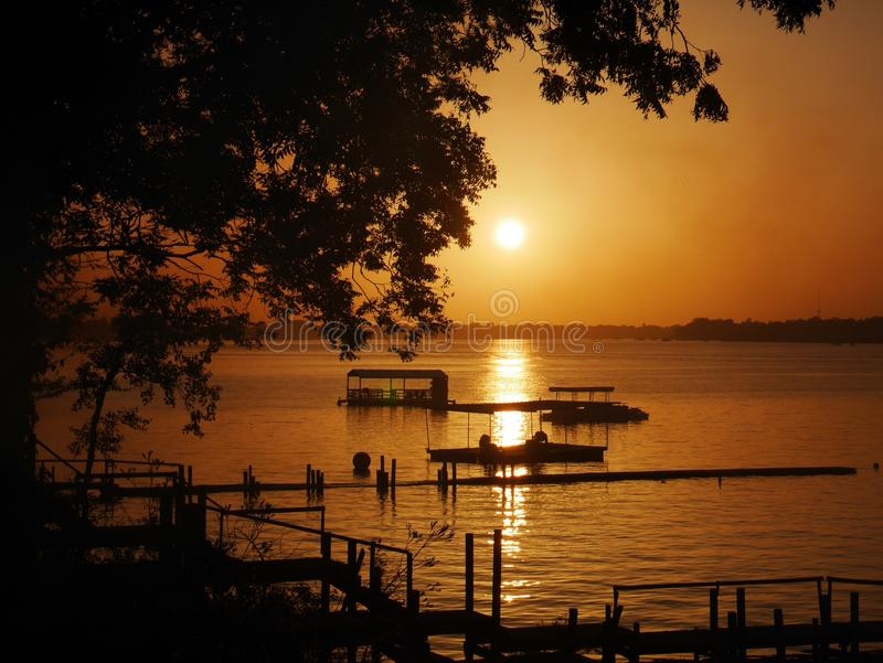 Заход солнца на старом реке стоковая фотография