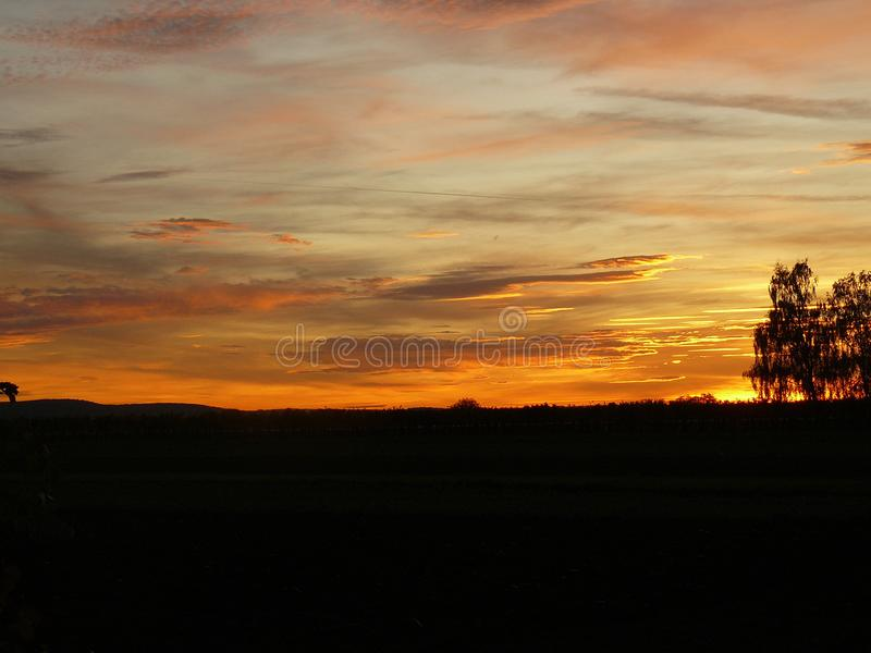 Заход солнца на стороне страны в Австрии стоковое фото
