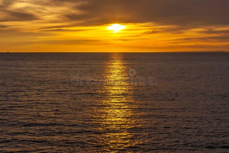 Заход солнца на Jimbaran, южном Kuta, Бали, Индонезии стоковая фотография