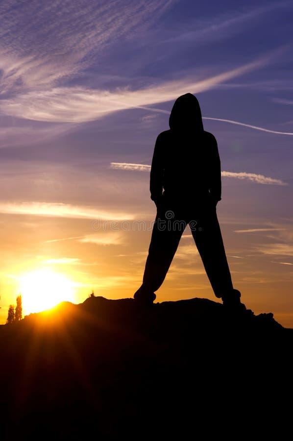 заход солнца неба человека стоковые изображения rf